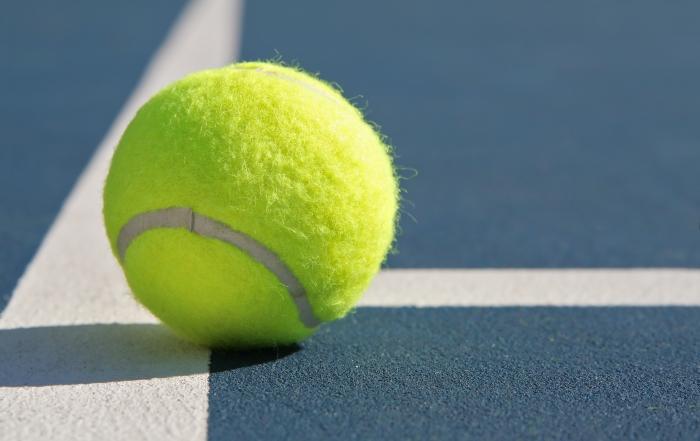 Tennis Ball on Blue Court